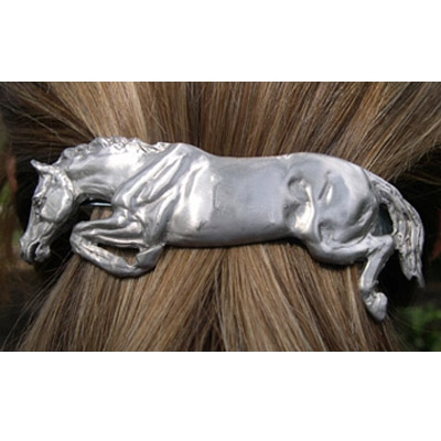 Jumping Horse Hair Clip Satin finish and comes on a hang card.